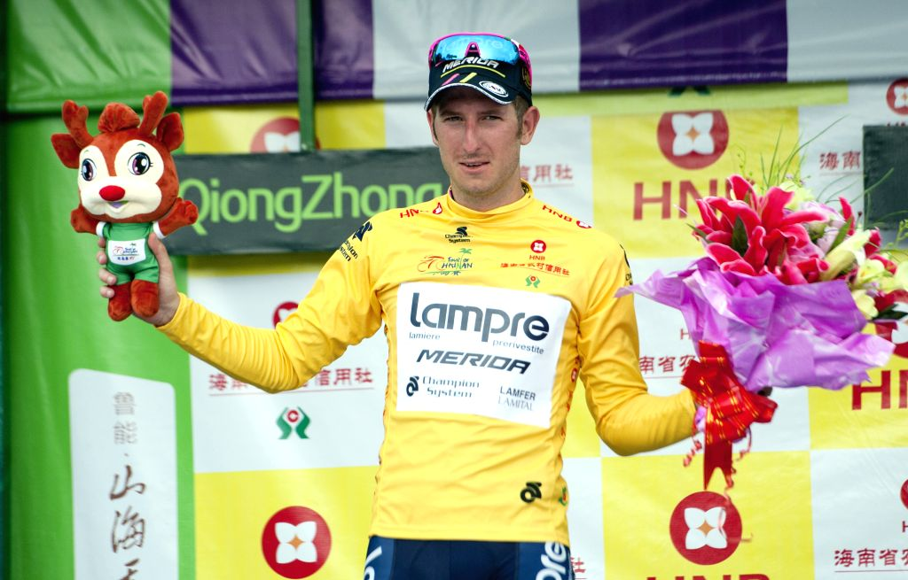 Sacha Modolo, who has got the yellow jersey, celebrates during the awarding ceremony after the 5th stage of the 2015 Tour of Hainan International Road Cycling ...