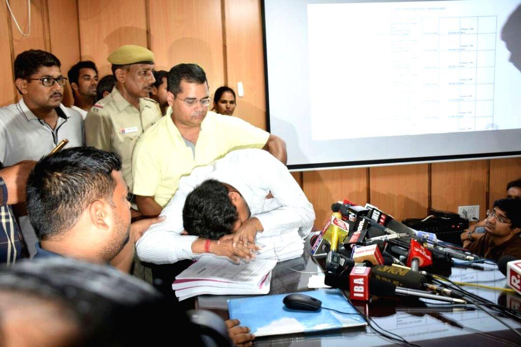 Sacked Delhi Minister Kapil Mishra faints during a press conference in New Delhi on May 14, 2017.Mishra, is on hunger strike since Wednesday demanding that Chief Minister Arvind Kejriwal ... - Kapil Mishra and Arvind Kejriwal