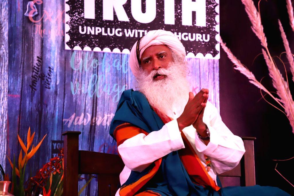 Sadhguru Jaggi Vasudev addresses during a press conference at press club, in Bengaluru on Sept 11, 2018.