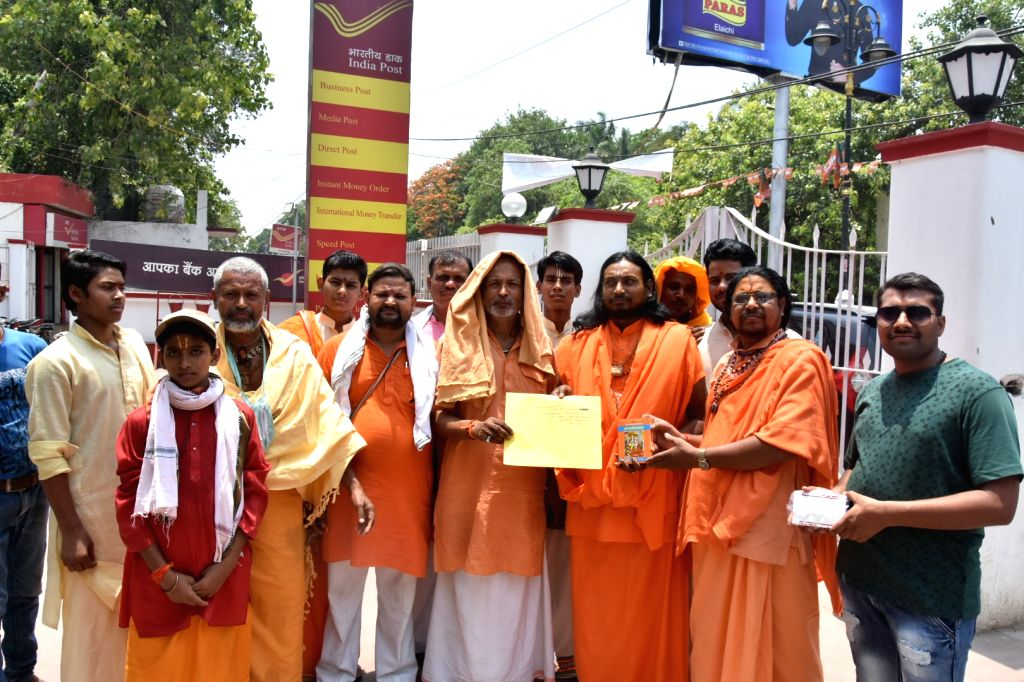 """Sadhus' arrive at a post office to parcel a copy of the Ramcharitmanas to West Bengal Chief Minister Mamata Banerjee for the way she is reacting to """"Jai Shri Ram"""" chants, in ... - Mamata Banerjee"""