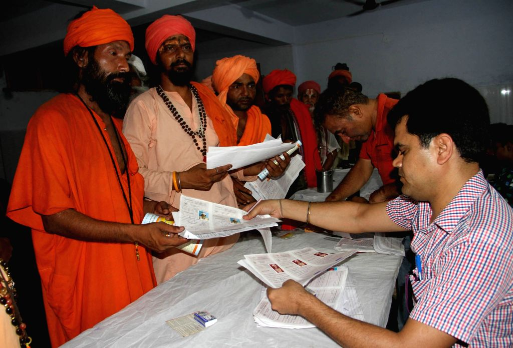 Sadhus wait to register for the annual pilgrimage to the Amarnath shrine at a base camp in Jammu June 27, 2017. The annual Amarnath Yatra to the holy cave shrine of Amarnath in Himalayas will ...