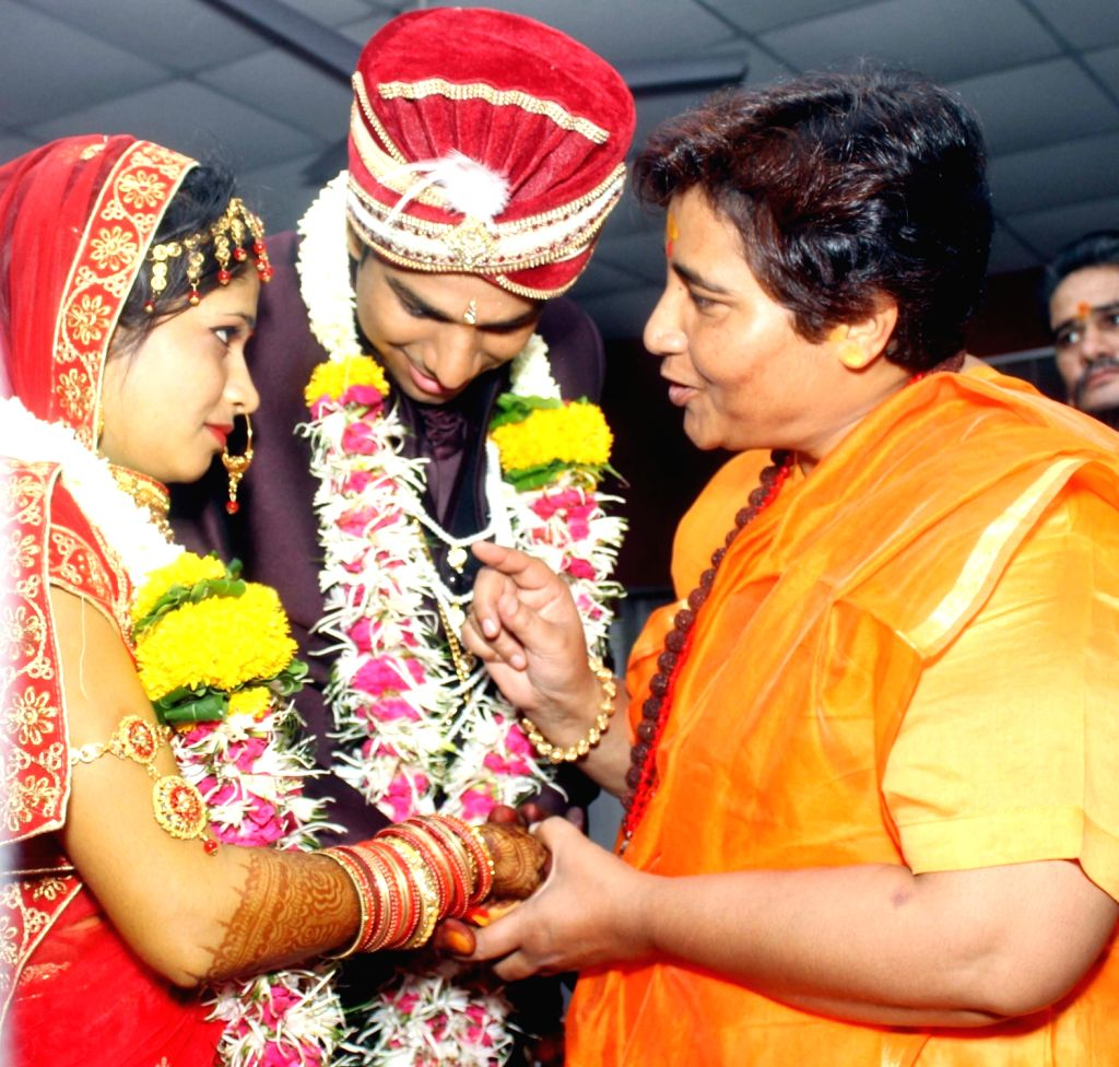 Sadhvi Pragya Singh Thakur speaks to a newly wed couple at a mass marriage ceremony in Bhopal on June 13, 2019.