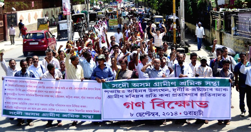 Sadou Asom Gramin Shramik Santha (SAGSS) participate in a rally to press for their various demands in Guwahati on Sept 8, 2014.