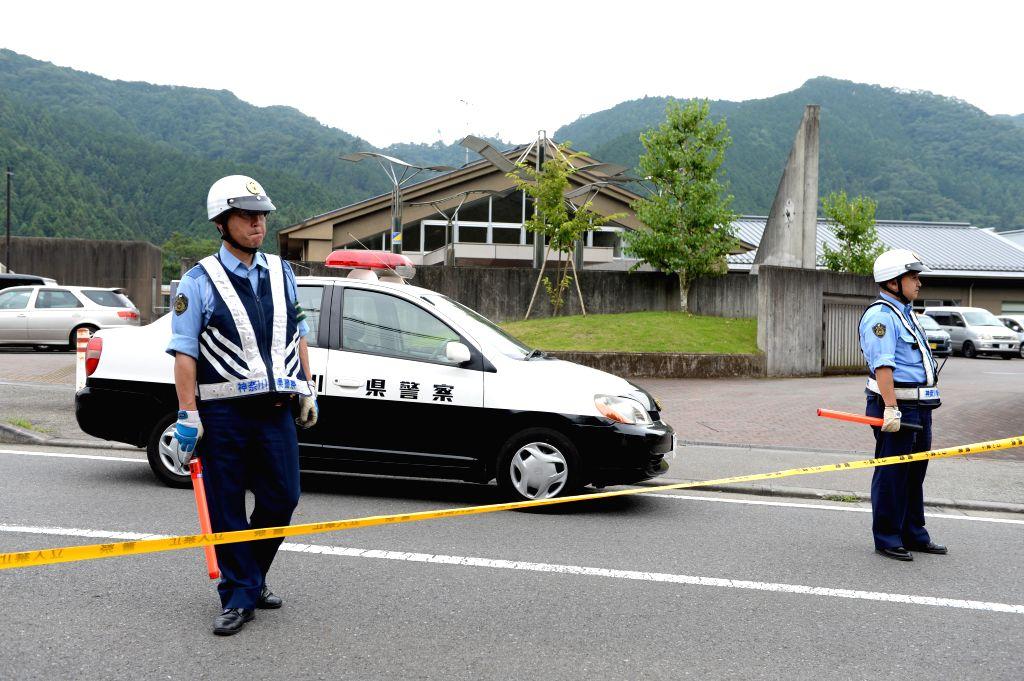 SAGAMIHARA, July 26, 2016 - Police officers stand guard outside the Tsukui Yamayuri-en (Tsukui Lily Garden) care facility in Sagamihara City, Japan's Kanagawa Prefecture, July 26, 2016. Following a ...