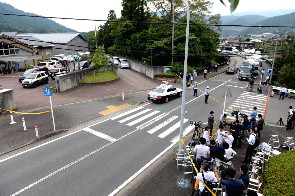 SAGAMIHARA, July 26, 2016 - Reporters gather outside of the Tsukui Yamayuri-en (Tsukui Lily Garden) care facility in Sagamihara City, Japan's Kanagawa Prefecture, July 26, 2016. Following a fatal ...