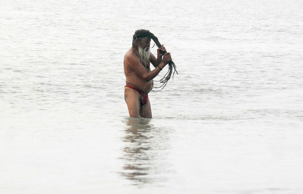 Sagar Island: An ascetic takes holy dip on the eve of Makar Sankranti in Sagar Island, West Bengal on Jan 13, 2017.