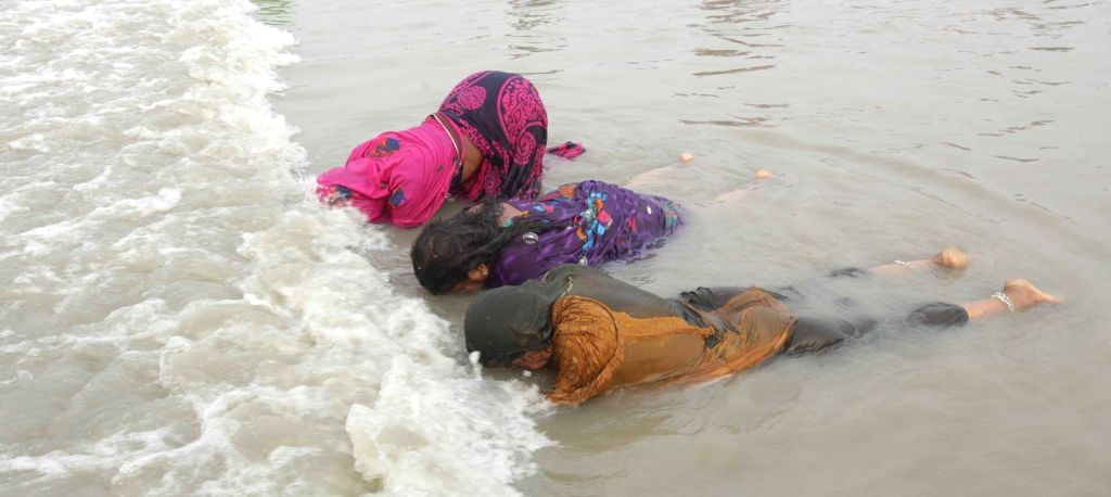 Sagar Island: Devotees take a holy dip ahead of Makar Sankranti in Sagar Island of West Bengal's South 24 Parganas, on Jan 14, 2016.