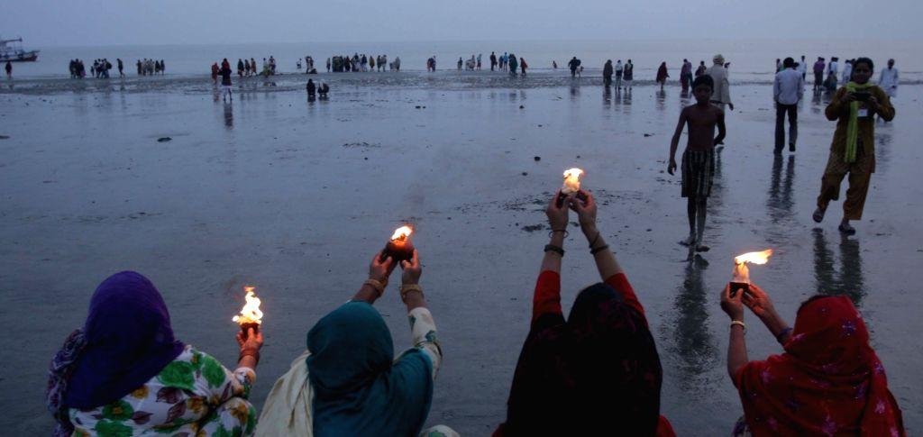 Sagar Island: Hindu pilgrims perform rituals at the confluence of the Ganga river and the Bay of Bengal during Gangasagar Mela at Sagar Island in South 24 Parganas district of West Bengal on Jan 12, ...