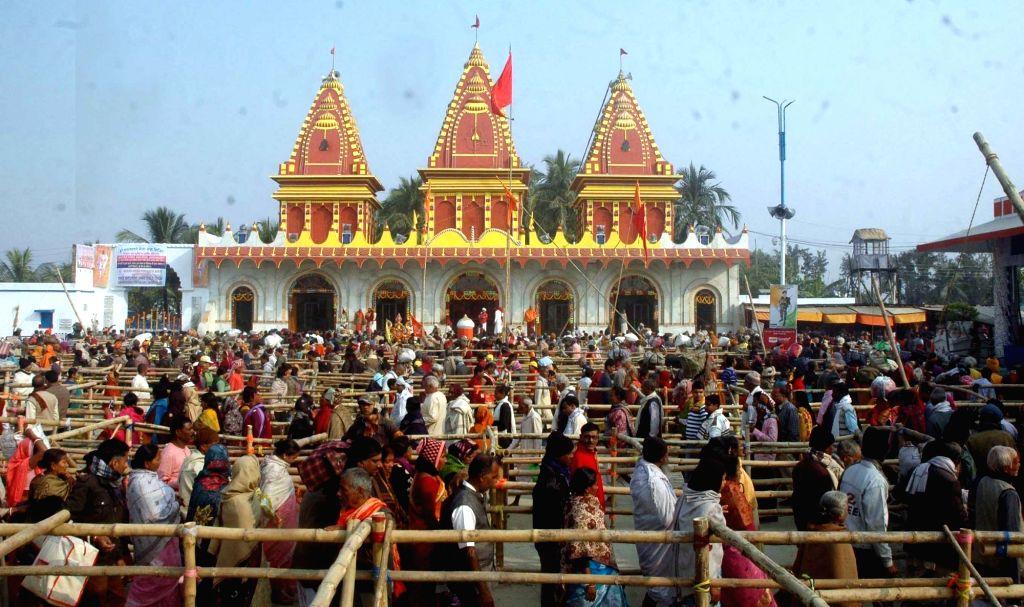 Sagar Island: People throng Kapil Muni Temple during Gangasagar Mela in Sagar Island of West Bengal's South 24 Parganas on Jan 12, 2017.
