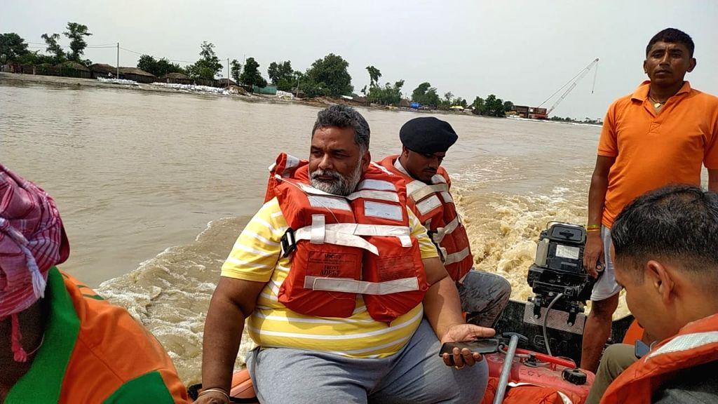 Sahara: Jan Adhikar Party leader Rajesh Ranjan alias Pappu Yadav during his visit to the flood affected Sahara in Bihar on July 15, 2019. (Photo: IANS) - Pappu Yadav