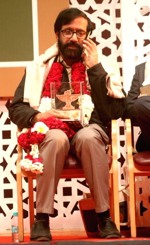 Sahitya Akademi Award winner Malayalam novelist and short story writer K.P. Ramanunni during the Sahitya Akademi Awards in New Delhi on Feb 12, 2018.