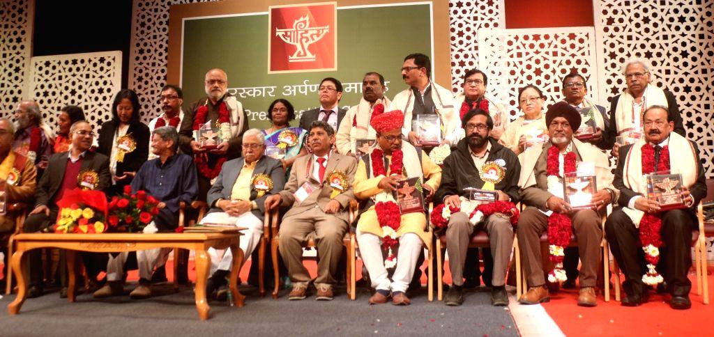 Sahitya Akademi Award winners with Sahitya Akademi Vice President Chandrashekhara Kambar during the Sahitya Akademi Awards 2017 in New Delhi on Feb 12, 2018.