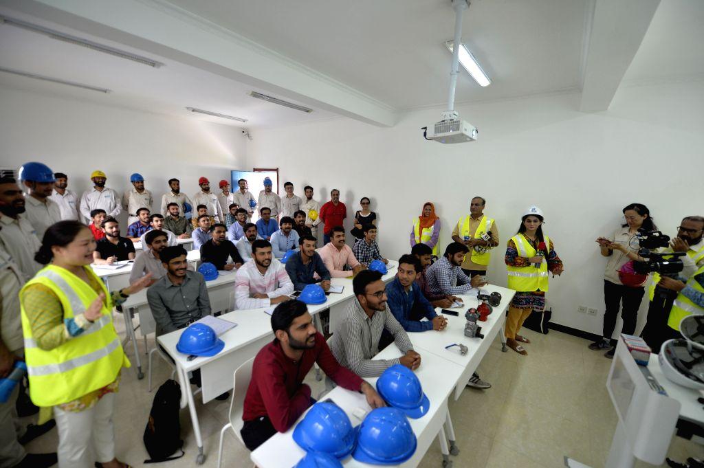 SAHIWAL (PAKISTAN), Aug. 11, 2019 Trainees study in a classroom at a training school of the Sahiwal Coal Power plant in Sahiwal, Punjab Province, Pakistan, on Aug. 6, 2019. Power plants ...