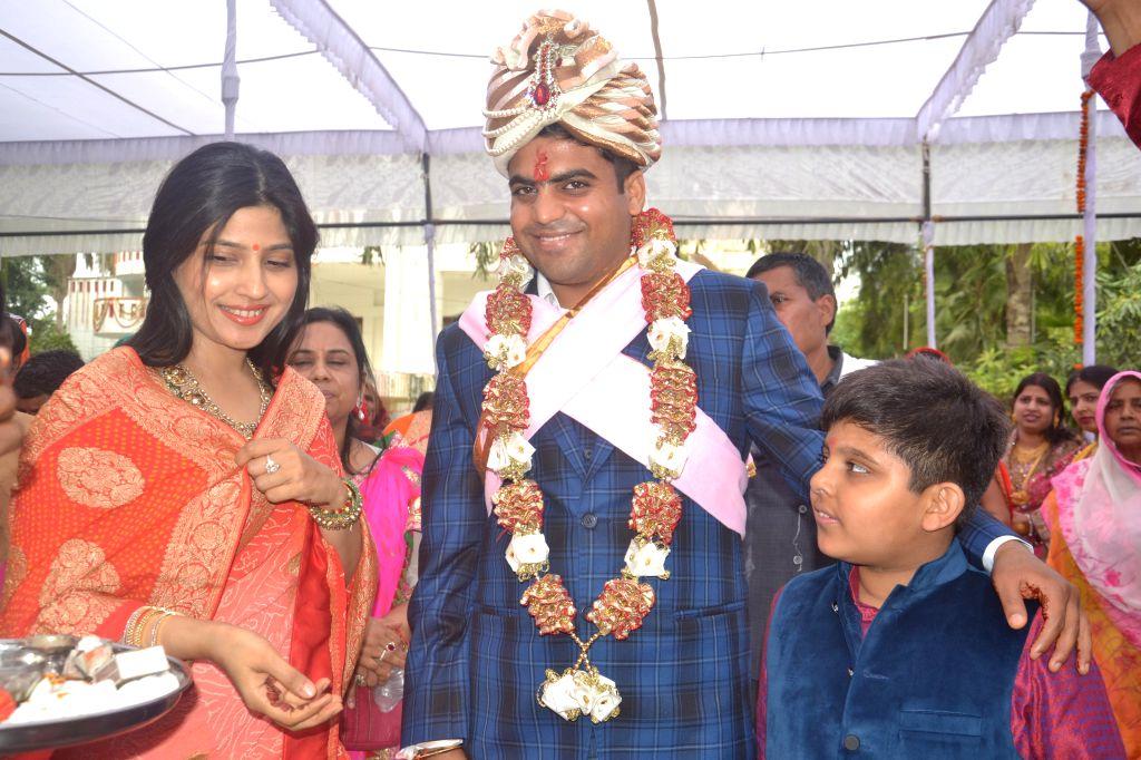 Samajwadi Party chief Mulayam Singh Yadav's grand nephew, Tej Pratap Yadav during a ceremony ahead of his marriage at Saifai in Uttar Pradesh  on Feb 26, 2015. Also seen his aunt and SP MP ... - Mulayam Singh Yadav and Kannauj Dimple Yadav