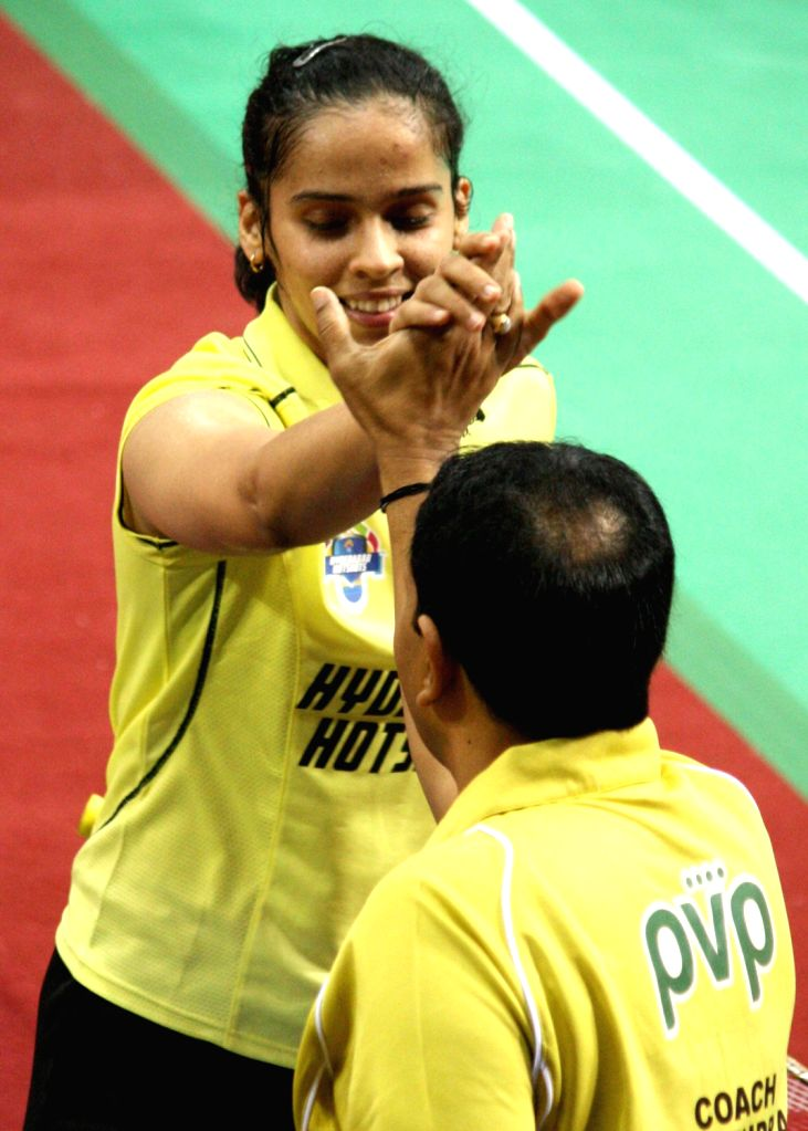 Saina Nehwal of Hyderabad Hotshots exults after winning the match against PV Sindhu of Awadhe Warriors at the Indian Badminton League in New Delhi on August 15, 2013. (Photo::: IANS)