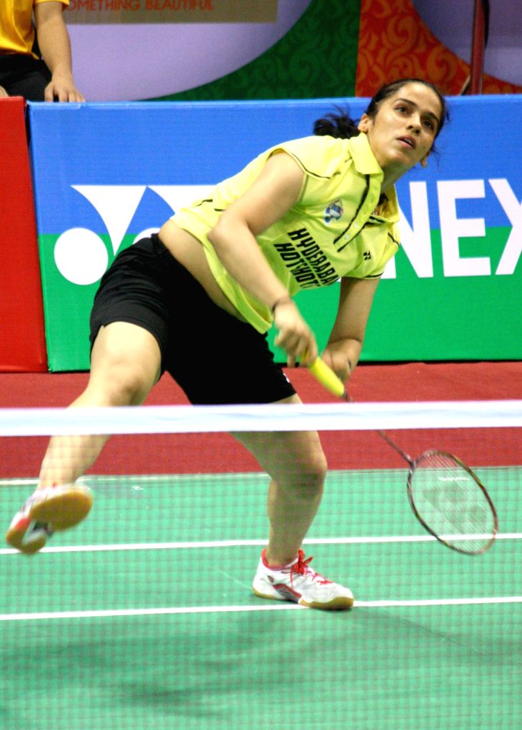 Saina Nehwal of Hyderabad Hotshots playing against PV Sindhu of Awadhe Warriors at the Indian Badminton League in New Delhi on August 13, 2013. (Photo::: IANS)