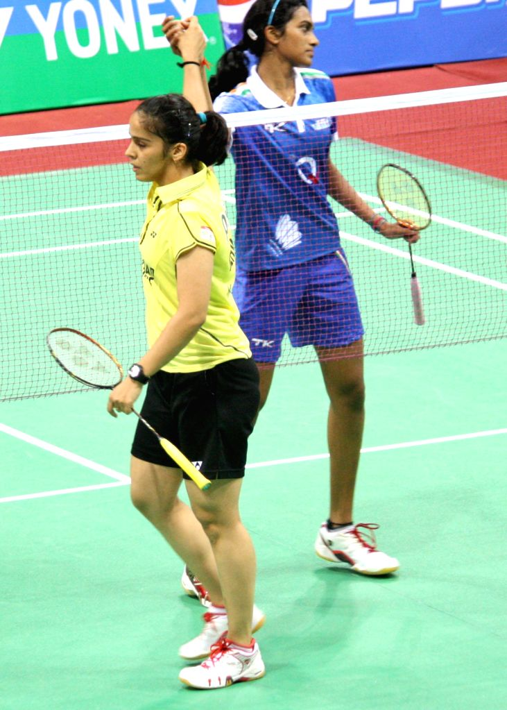 Saina Nehwal of Hyderabad Hotshots shake hand with PV Sindhu of Awadhe Warriors after wining the match at the Indian Badminton League in New Delhi on August 15, 2013. (Photo::: IANS)