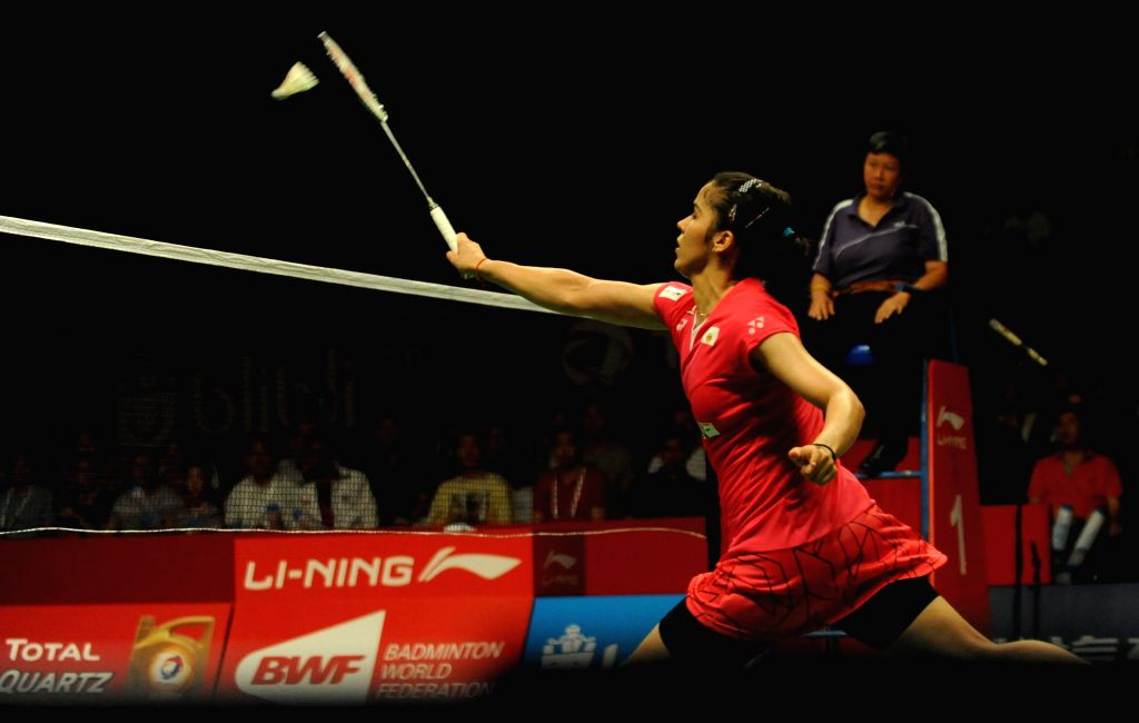 Saina Nehwal of India (front) returns the shuttlecock to Lindaweni Fanetri of Indonesia during her women's singles match at the BWF World Championships 2015 in ...