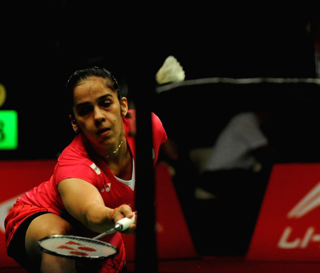 Saina Nehwal of India returns the shuttlecock to Lindaweni Fanetri of Indonesia during her women's singles match at the BWF World Championships 2015 in Jakarta, ...