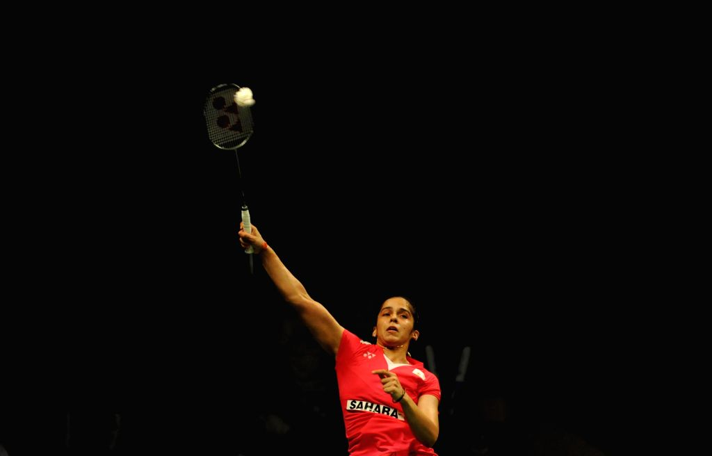 Saina Nehwal of India returns the shuttlecock to Lindaweni Fanetri of Indonesia during the women's singles semifinal match at the BWF World Championships 2015 in ...