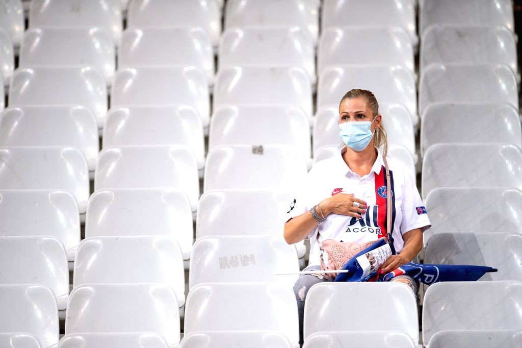 Saint-A fan wearing a face mask is seen during the French League Cup final football match between Paris Saint-Germain and Olympique Lyonnais at the Stade de France in ...