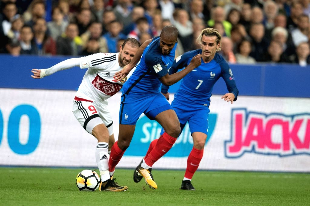 SAINT-Djibril Sidibe (C) and Antoine Griezmann (R) of France compete with Ihar Stasevich (L) of Belarus during the 2018 World Cup group A qualifying football match ...
