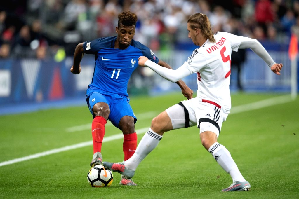 SAINT-Kingsley Coman (L) of France competes with Maksim Valadzko of Belarus during the 2018 World Cup group A qualifying football match between France and Belarus at ...