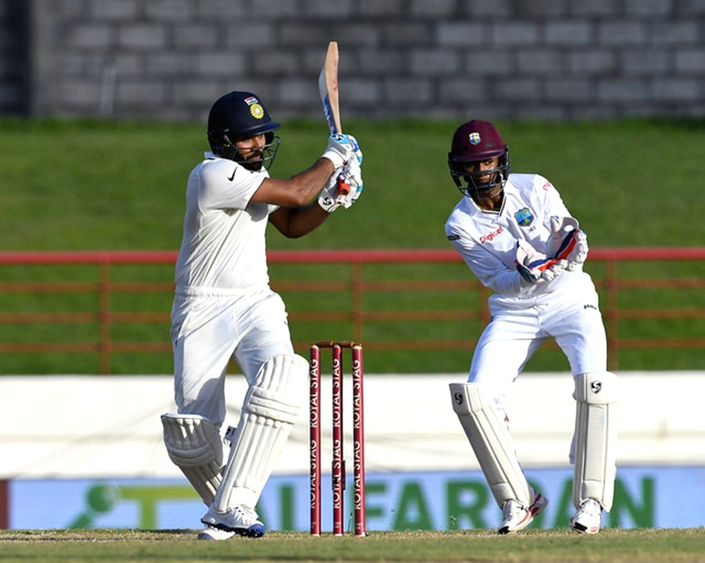 Saint Lucia: Indian batsman Rohit Sharma in action during the fifth day of the third test match between India and West Indies at Darren Sammy National Cricket Stadium in Gros Islet, Saint Lucia on ... - Rohit Sharma