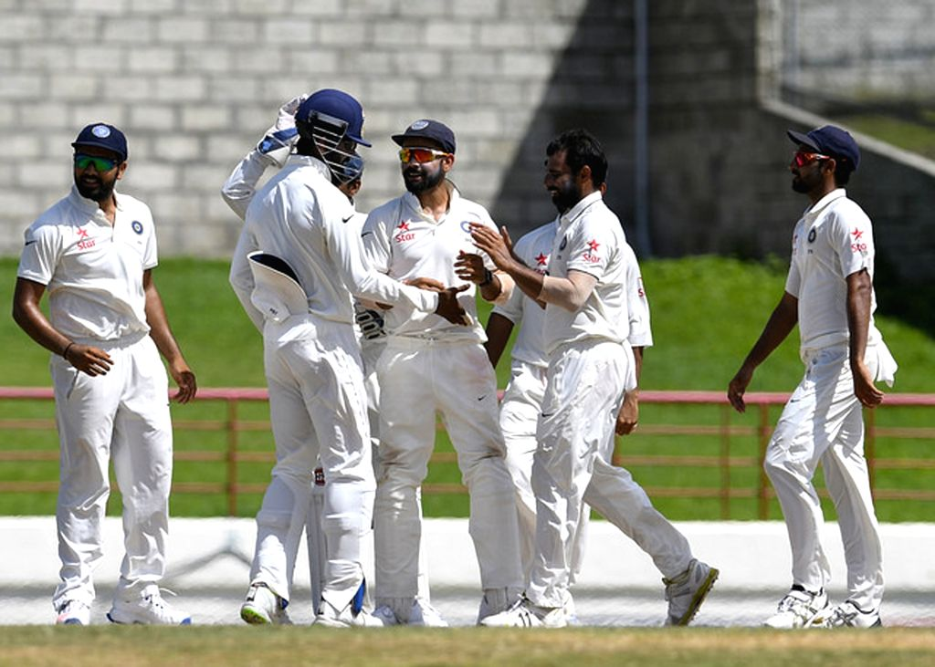 Saint Lucia: Indians celebrate after winning the third test match between India and West Indies at Darren Sammy National Cricket Stadium in Gros Islet, Saint Lucia on Aug 13, 2016.