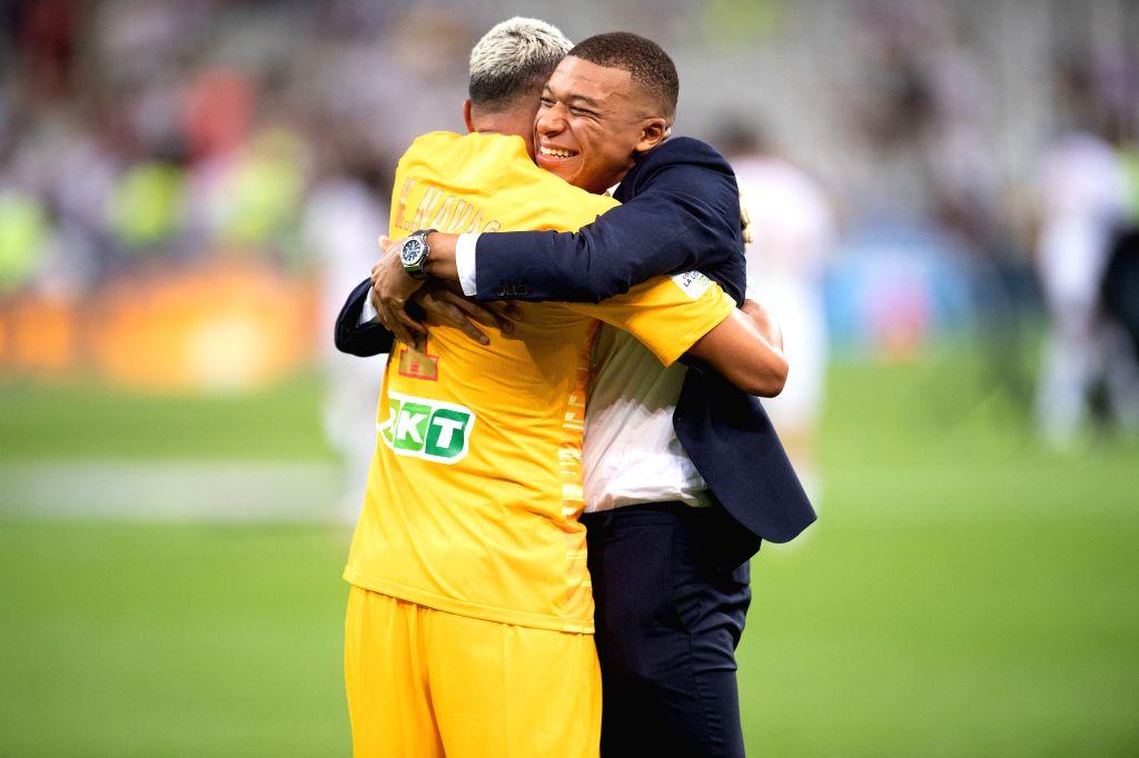 Saint-Paris Saint-Germain's goalkeeper Keylor Navas (L) celebrates with Kylian Mbappe after winning the French League Cup final football match between Paris ...