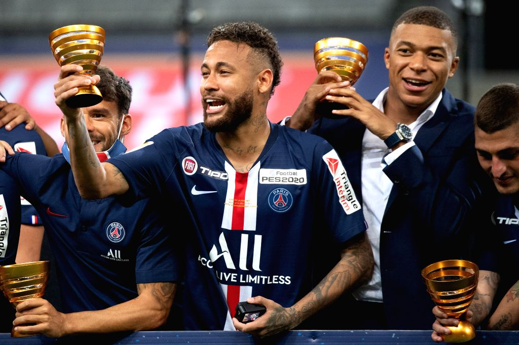 Saint-Paris Saint-Germain's Neymar (2nd L) celebrates with Kylian Mbappe (2nd R) during the awarding ceremony of the French League Cup final football match between ...