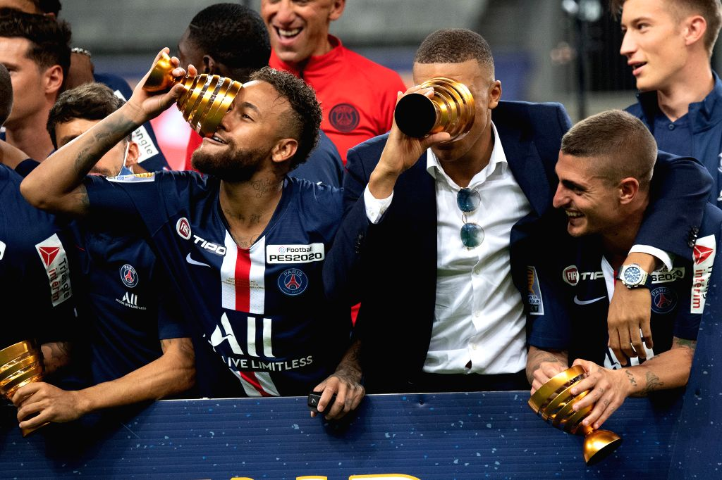 Saint-Paris Saint-Germain's Neymar (2nd L, front) celebrates with Kylian Mbappe (2nd R, front) during the awarding ceremony of the French League Cup final football ...