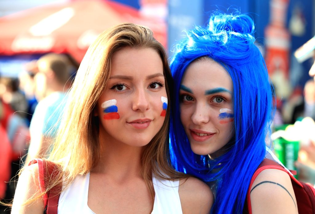 Saint Petersburg: Two football fans pose during a FIFA fan fest in Saint Petersburg, Russia, on June 14, 2018, the opening day of the World Cup.