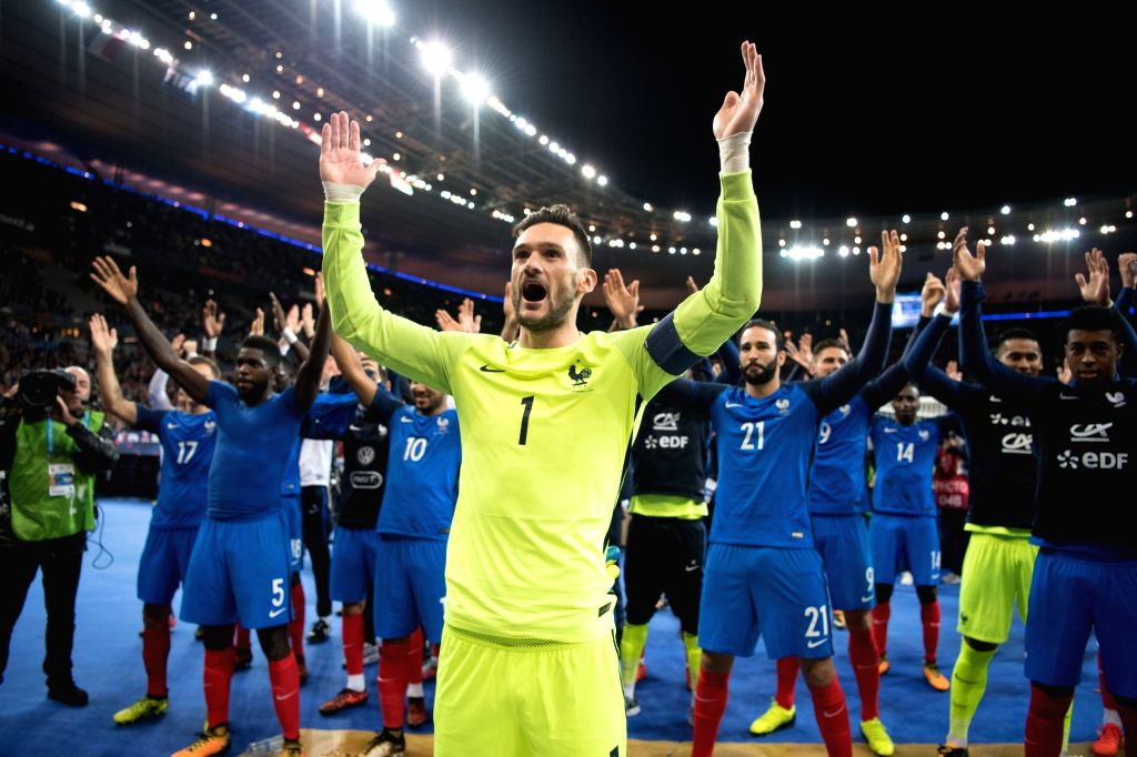 SAINT-Players of France celebrate their victory after the 2018 World Cup group A qualifying football match between France and Belarus at the Stade de France in ...