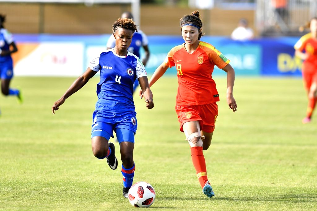 SAINT-Shen Mengyu (R) of China vies with Emeline Charles of Haiti during the Group D match of 2018 FIFA U-20 Women's World Cup in Saint-Malo, France on Aug. 6, 2018. ...
