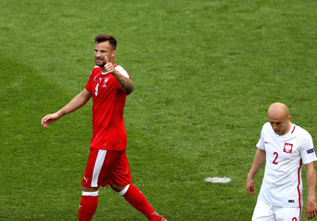 SAINT-Switzerland's Haris Seferovic(L) reacts during the Euro 2016 round of sixteen football match between Switzerland and Poland in Saint-Etienne on June 25, 2016.