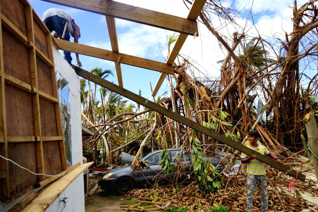 SAIPAN, Nov. 1, 2018 - Residents repair their house in Saipan, the Commonwealth of the Northern Mariana Islands (CNMI), Oct. 31, 2018. Super Typhoon Yutu landed in the United States' or its ...