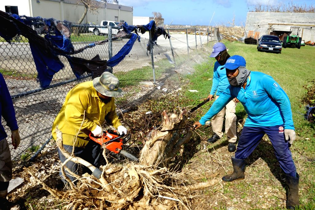 SAIPAN, Nov. 1, 2018 - Workers clean fallen trees in Saipan, the Commonwealth of the Northern Mariana Islands (CNMI), Oct. 31, 2018. Super Typhoon Yutu landed in the United States' or its ...