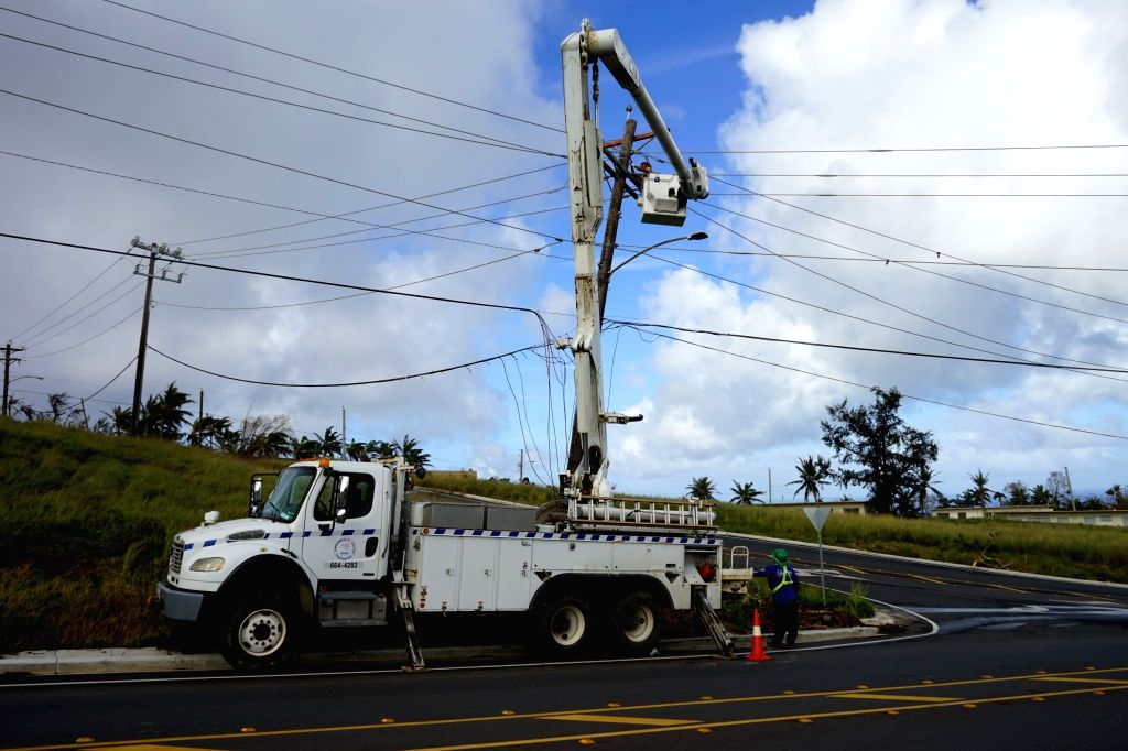 SAIPAN, Nov. 1, 2018 - Workers repair power system in Saipan, the Commonwealth of the Northern Mariana Islands (CNMI), Oct. 31, 2018. Super Typhoon Yutu landed in the United States' or its ...