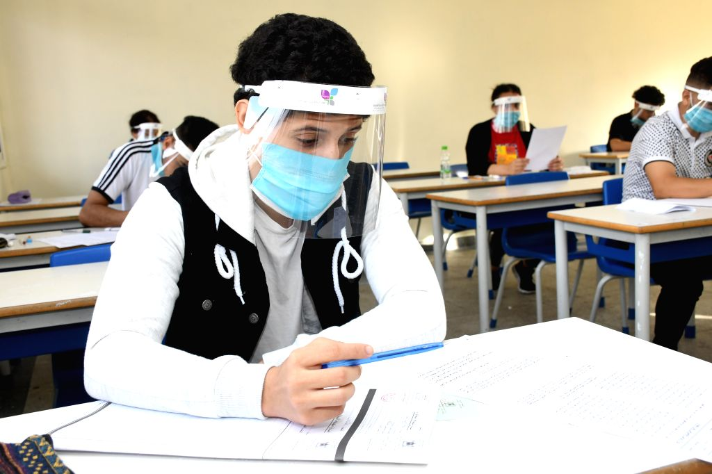 Sale (Morocco), July 3, 2020 A student wearing a mask and a shield participates in a college entrance exam in Sale, Morocco, on July 3, 2020. A total of 319 new COVID-19 cases were ...