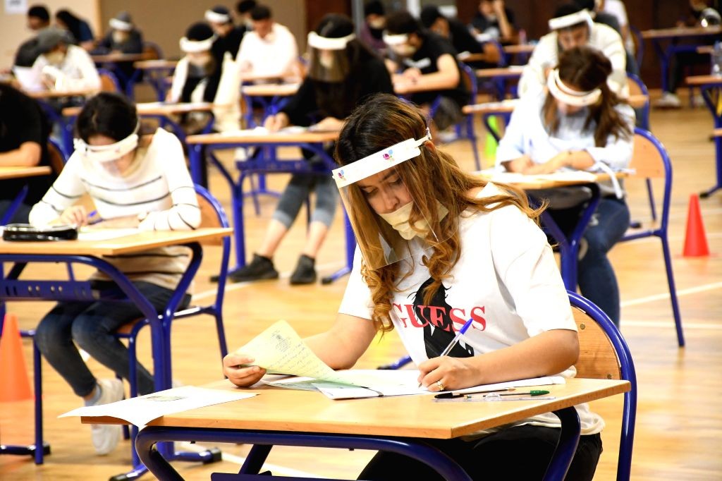 Sale (Morocco), July 3, 2020 Students wearing masks and shields participate in a college entrance exam in Sale, Morocco, on July 3, 2020. A total of 319 new COVID-19 cases were confirmed ...
