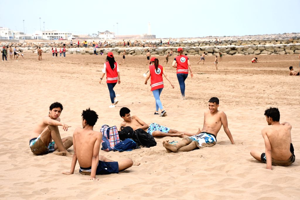 SALE (MOROCCO), June 25, 2020 People are seen on a beach in Sale, Morocco, on June 25, 2020. Morocco on Thursday announced 431 new COVID-19 infections, raising the total number of ...