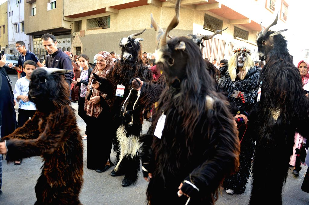 SALE (MOROCCO), Sept. 28, 2019 People wearing masks and special costumes participate in the Boujloud Festival in Sale, Morocco, on Sept. 28, 2019. The annual Boujloud Festival, also known ...