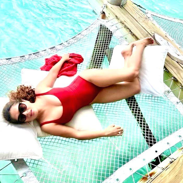 Salma Hayek looks fiery hot in monokini post.(photo:Instagram)