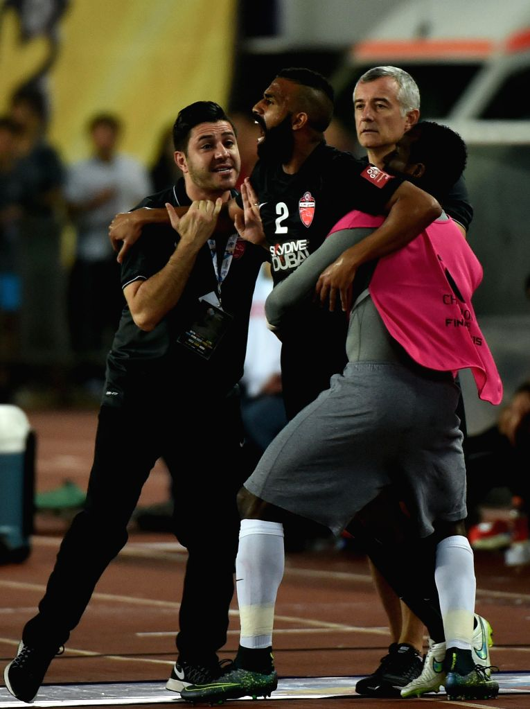 Salmin Khamis (C) of Al Ahli of United Arab Emirates reacts after receiving a red card during the 2nd round of the AFC Champions League final match between ...
