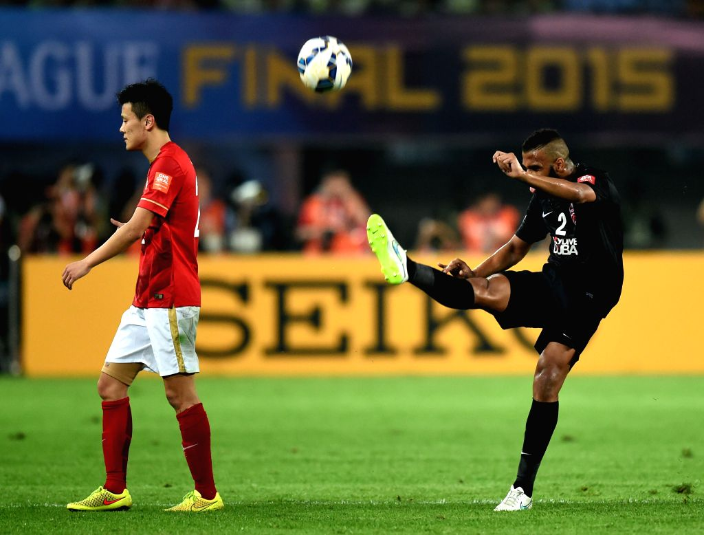 Salmin Khamis (R) of Al Ahli of United Arab Emirates kicks the ball away after receiving a red card during the 2nd round of the AFC Champions League final match ...