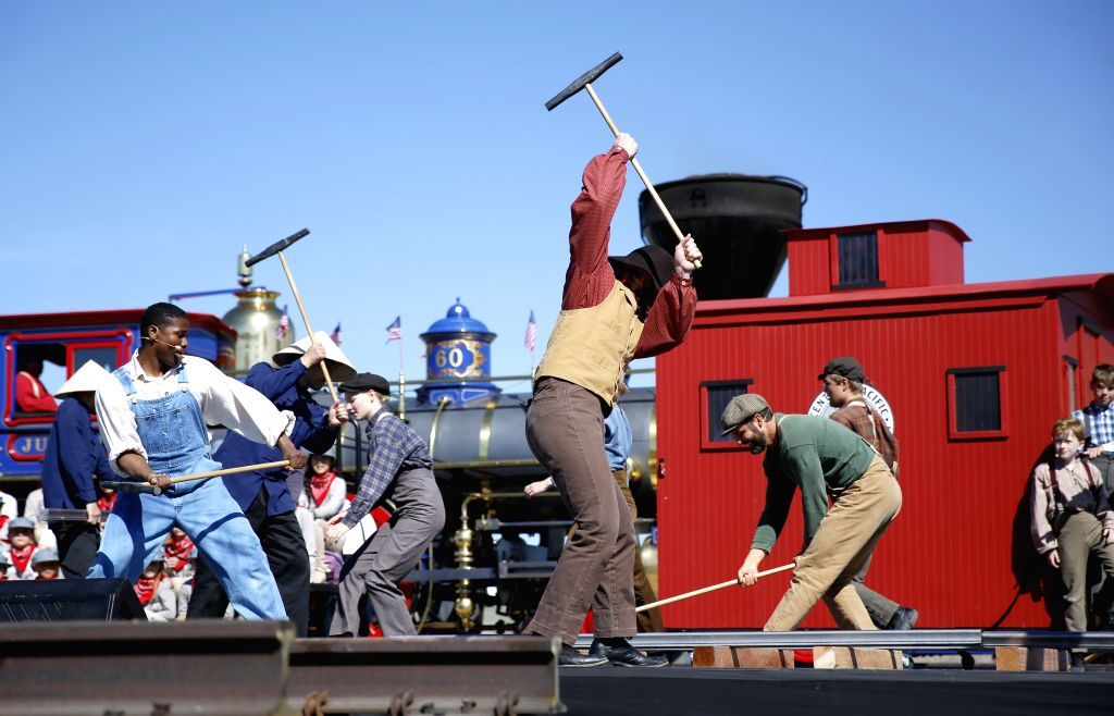 SALT LAKE CITY, May 11, 2019 - Performers play the roles of railroad workers during a historical re-enactment to celebrate the 150th anniversary of the completion of the first U.S. transcontinental ...