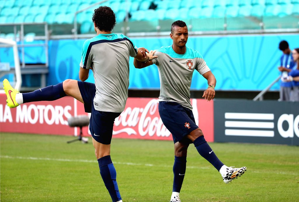 Portugal's Nani (R) warms up during a training session at the Arena Fonte Nova Stadium in Salvador, Brazil, on June 15, 2014. A Group G match of 2014 FIFA World ...