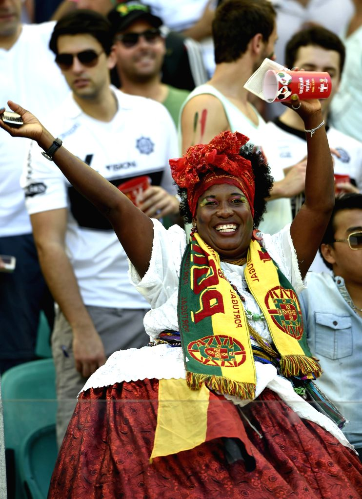A Portugal's fan cheers before a Group G match between Germany and Portugal of 2014 FIFA World Cup at the Arena Fonte Nova Stadium in Salvador, Brazil, June 16, ...