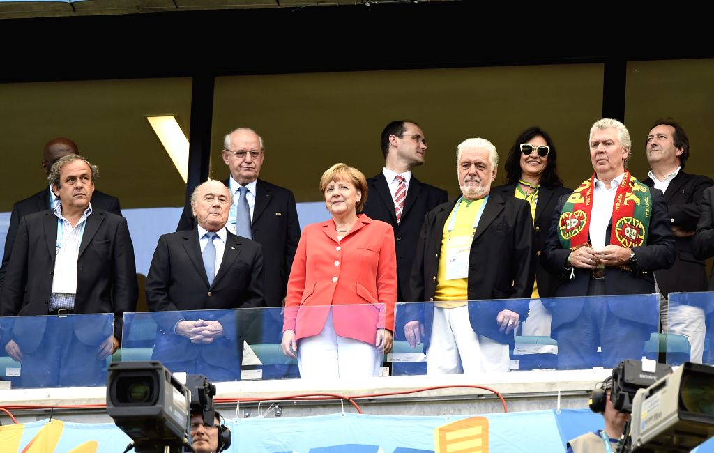 Chancellor of Germany Angela Merkel (C, front) watches a Group G match between Germany and Portugal of 2014 FIFA World Cup at the Arena Fonte Nova Stadium in ...